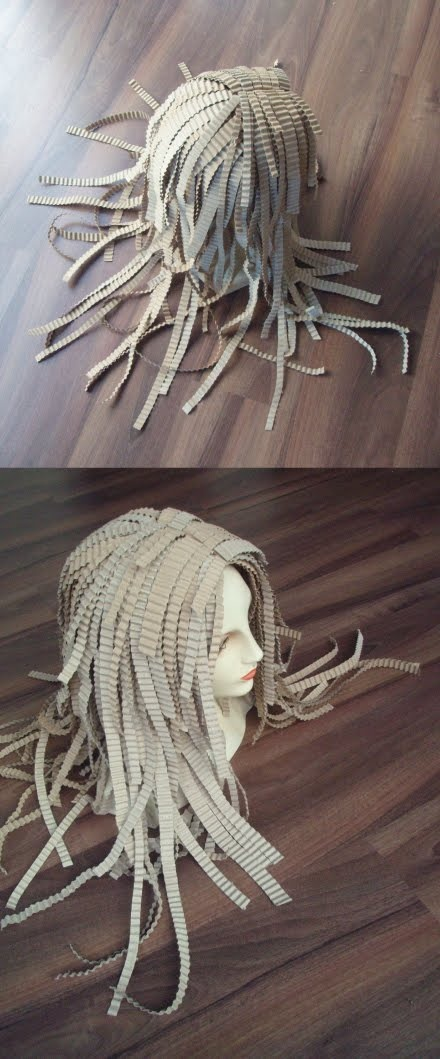 wigs made from paper, plastic, cardboard.. and some other odd recycled crafts (site's in spanish & didn't see a tutorial unless there were links that i overlooked..)
