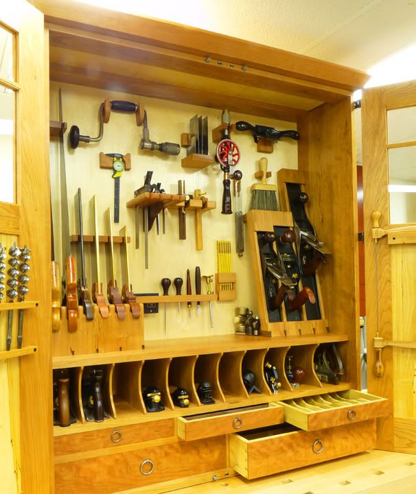 I totally have a crush on a guy who's kinda OCD... Im thinking he would really love this.... And never let me touch it :) Beautiful hand tool cabinet. There are close up photos of the joints at the link destination.