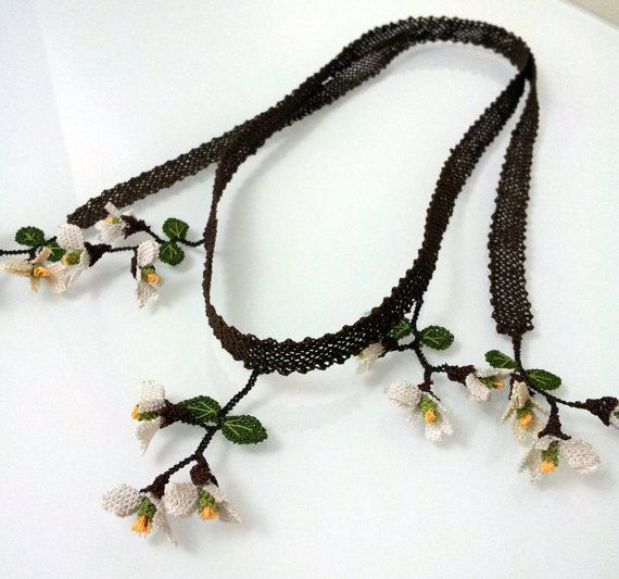 brown base white and yellow spring flowers long by needlecrochet, $90.00