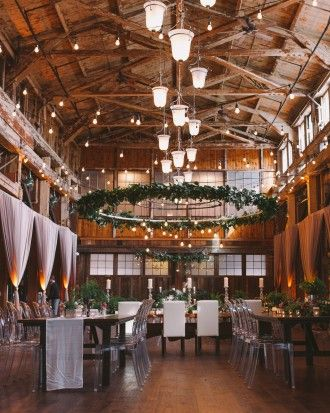 """Restored Warehouses Where You Can Tie the Knot - Built in 1907 for use by the Stetson-Ross Manufacturing Company, which created woodworking tools for ships, Sodo Park is directly tied to the original building, and still reflects those roots today: The factory floor is now the venue's dining room, while the coat-check space was originally used as a vault for Stetson-Ross. SoDo Park, short for """"South of Downtown,"""" is nestled in the heart of Seattle's historic district."""