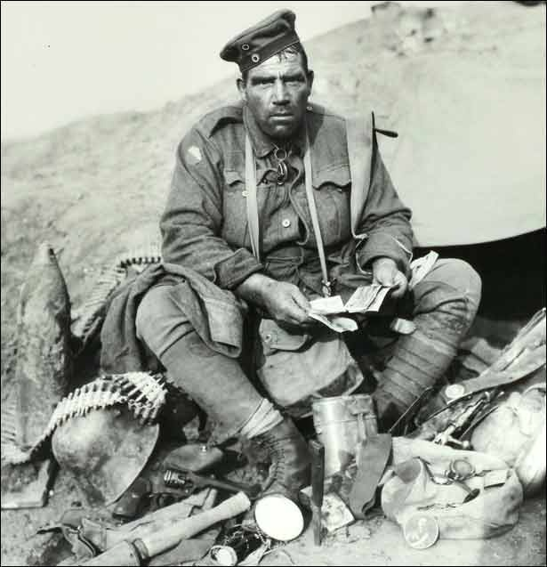 """Australian soldier Pvt Barney Hines after the battle of Polygon Wood shown with his collection of German souvenirs. He was known as the """"Souvenir King"""" of WWI"""