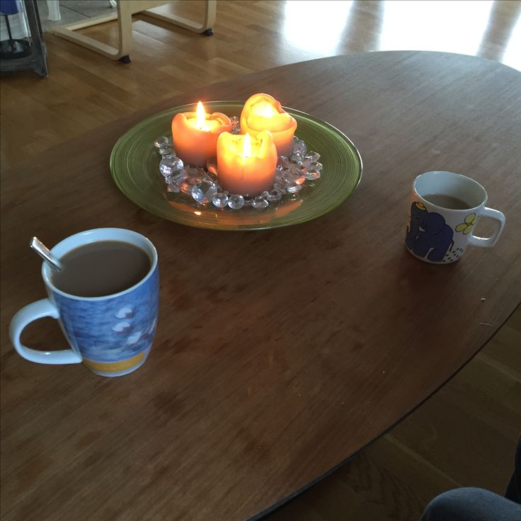 "Morning coffee, early fall. Glass plate with ""diamonds"" and fall-color candles."
