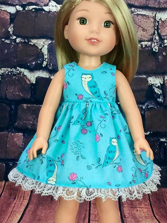 14.5 inch doll dress made to fit Wellie Wishers size dolls. Blue Owl doll clothes  This cute little dress is made from cute owls and Pink flowers on Blue fabric. Bodice is lined and hel is decorated in White lace. Dress closes in back with velcro.  My doll and her shoes are not