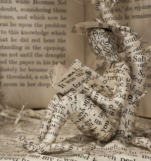 http://staceythinx.tumblr.com/post/48697655912/book-art-by-emma-taylor-you-can-buy-photographic