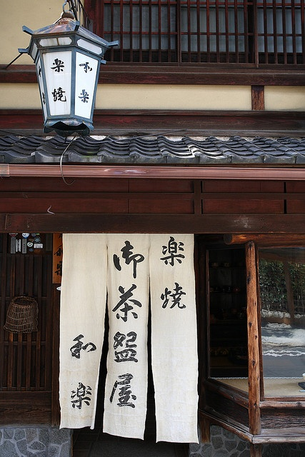 """Higashiyama Yasaka, Kyoto. Noren is traditional Japanese sign on fabric in front of a store. This is traditional chinaware store """"Kawasaki Waraku"""". The store has been in existence for about 200 years."""