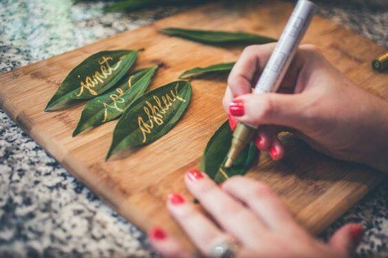 DIY Table Cards on Leaves Idea: Add small, eco-friendly touches to your boho wedding reception by using handwritten leaves as your table cards. Check out more ideas on our June Weddings site and make a date every Saturday night 9/8c with an original Hallmark Channel movie about love! #juneweddings #Eco-Friendly