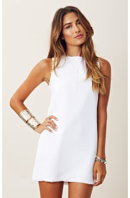 Straight white minidress with cuff bracelets
