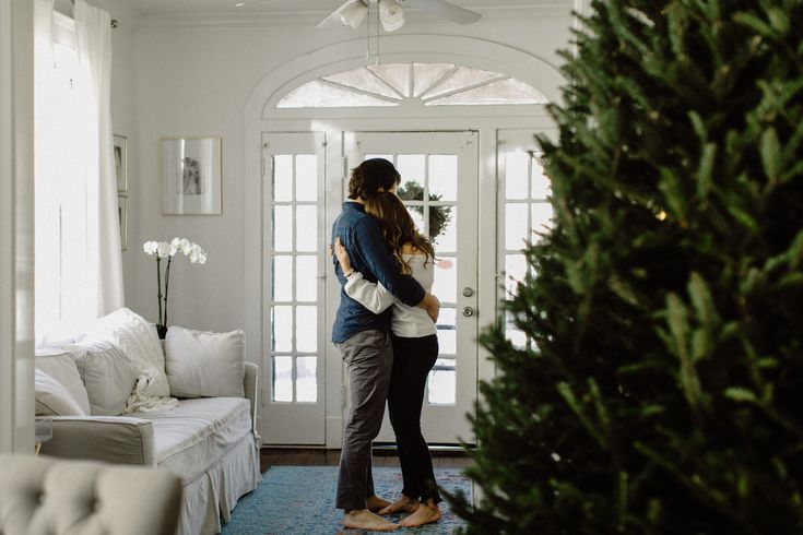 couple dancing in living room engagements inside lifestyle photography in home photography session kristen soileau portraits new orleans photographer …