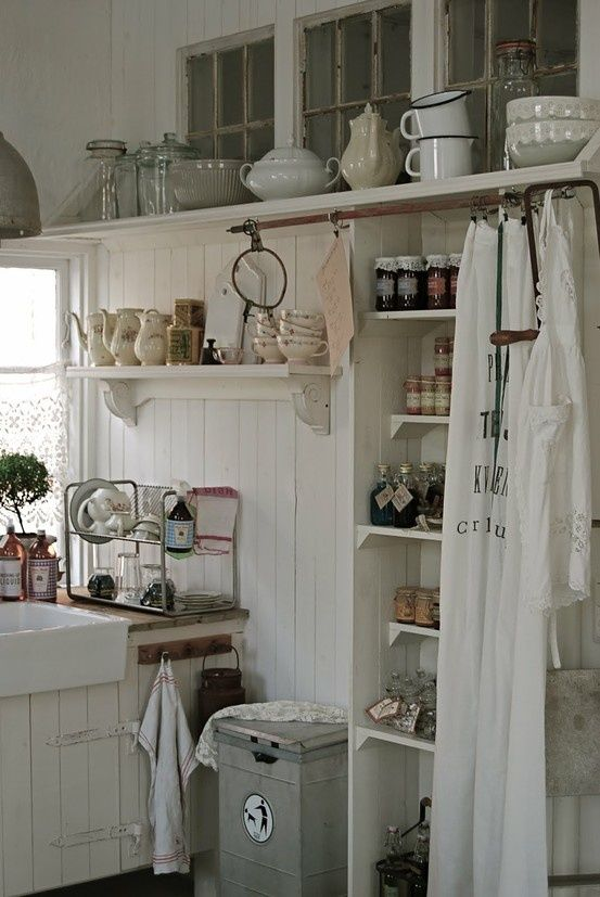 Love the curtain over the open pantry. Lovely shabby kitchen.