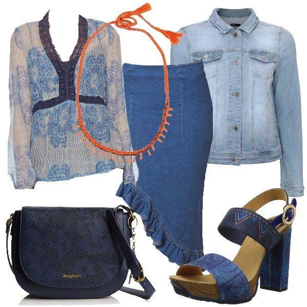 In questo insieme la gonna è protagonista, asimmetrica ed in jeans. Possiamo abbinarci una blusa semitrasparente ed un giacchetto di jeans. Scarpe alte e borsa sono sui toni del blu.
