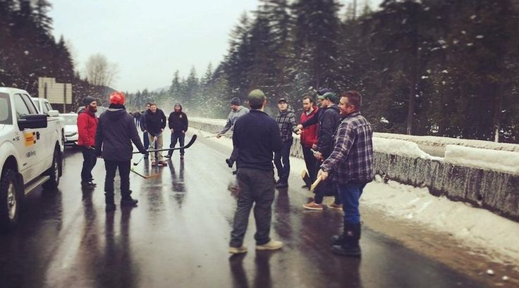 People stranded on the Coquihalla Highway during a snowfall-induced closure decided to kill some time by playing road hockey.