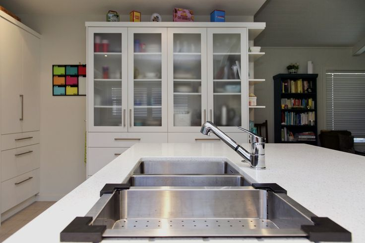 Designed using the Robiq stainless steel sink, Misty chrome tap, Eurostone Canadian White benchtop and Gudgeon handles, all from: www.heritagehardware.co.nz