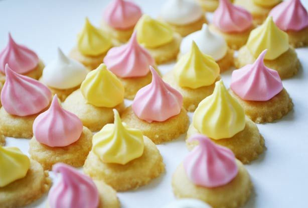 Iced gem biscuits are a childhood favourite and now you can make your own! This simple recipe is perfect for young helpers to get involved in the entire process. They can roll and cut out the biscuit dough, transform the icing into pretty colours and practise their piping skills. These homemade iced gem biscuits are such fun for a child's party or for a cheerful homemade treat.