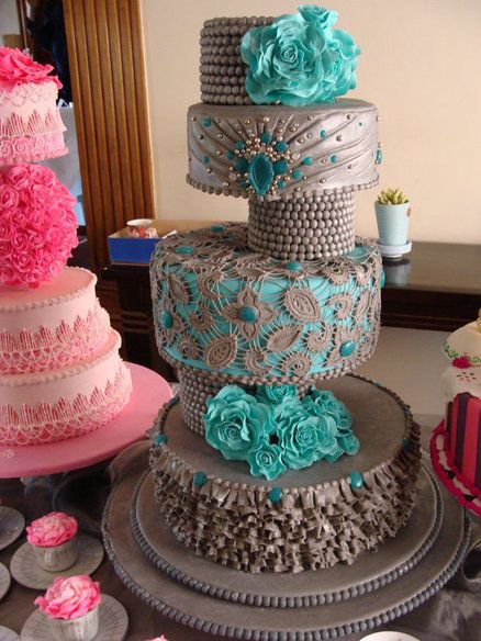 Grey wedding cake with ruffles and lace