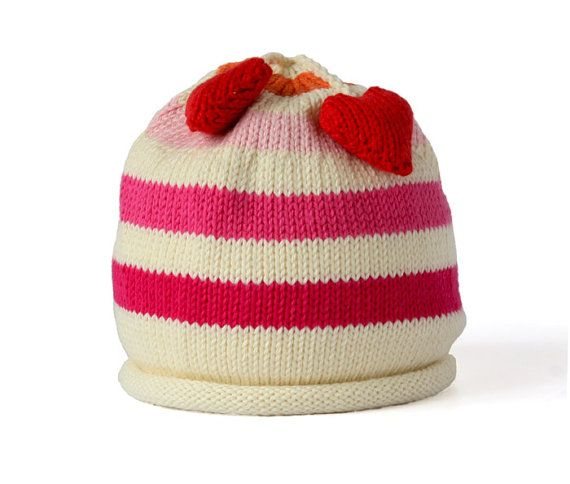 *Our baby hat with fun heart tassles is both cute and functional. Hand made from 100% cotton. Size small is 6 x 5 (0 - 6 months), medium is 6.5 x