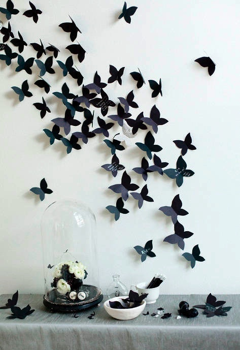 black butterflies on the wall.. lovely but wouldn't do black for the nursery.