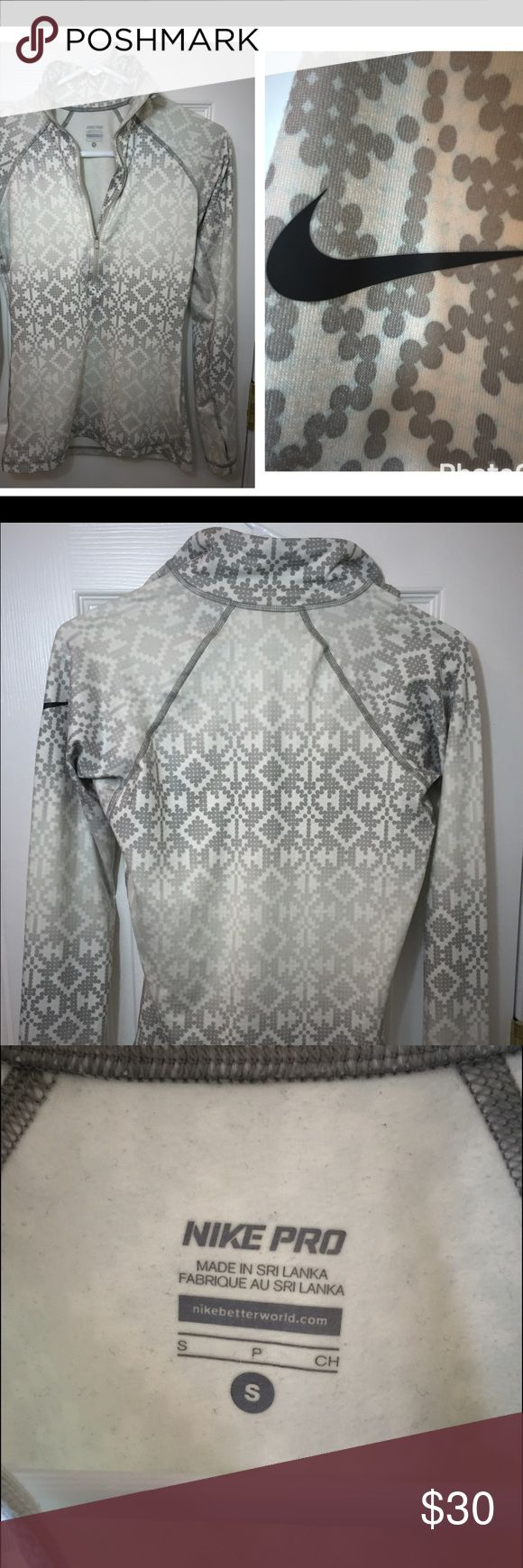 Nike Pro. Athletic top. Gray for morning or evening jogs or just hanging out. Nice and comfortable Nike Tops