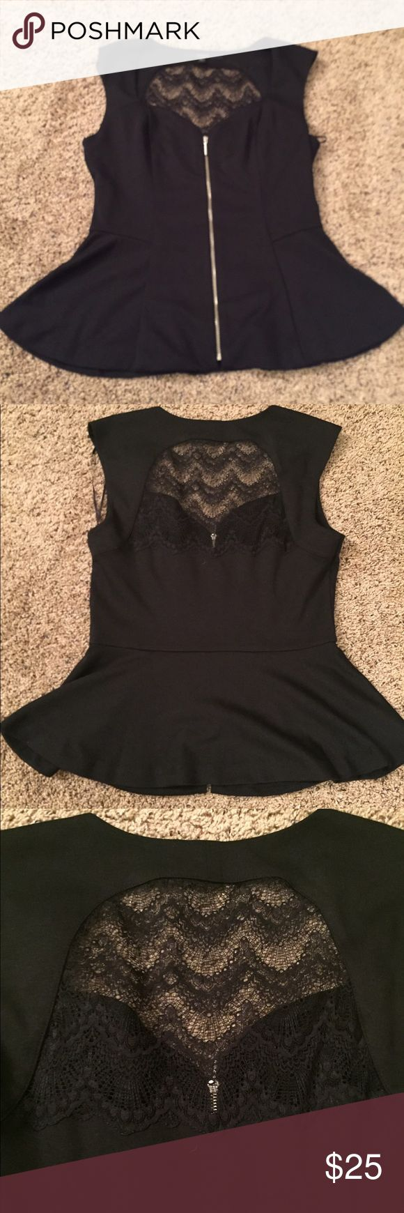 Lace peplum top The zipper front detail and lace back of this peplum top gives this top the perfect rocker chic look. I love this top, but sadly don't have the right body for the shape. Only worn once, maybe. Don't miss out on this one! Guess Tops Blouses