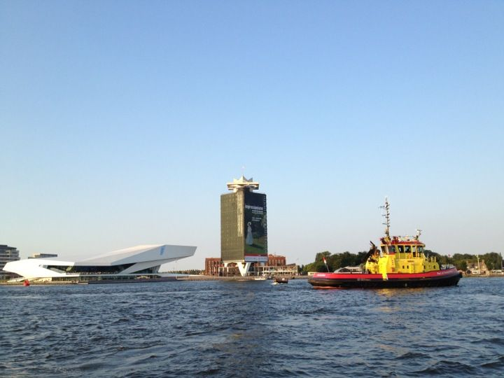 Free ferry across the IJ to the North. Departs from Centraal Station. http://en.gvb.nl/reisinformatie/plattegronden/Pages/Verenkaart.aspx