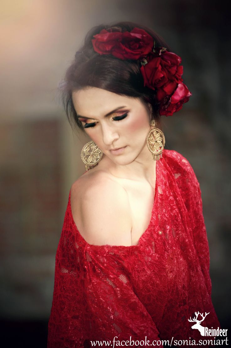 Portrait of a bride in a red dress. Special photo idea vintage spanish inspired wedding