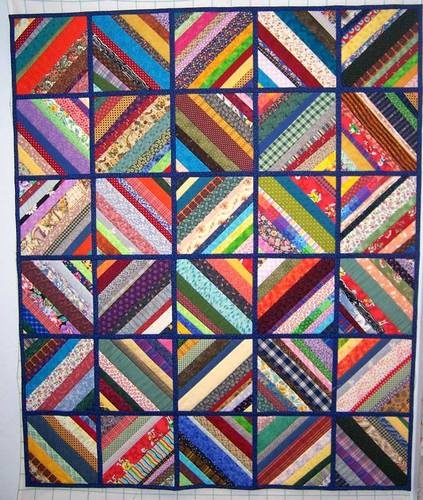 I love having a way to use up leftover fabric - this is a beautiful string quilt!