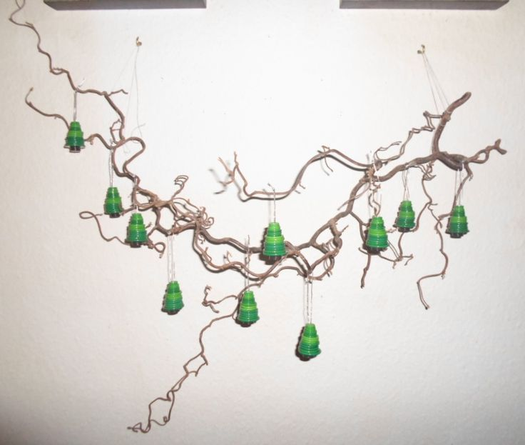 Christmas trees made out of bottons hanging on a Harry Lauder's walking stick.