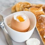Eat while the egg is warm! Eat the egg straight from the shell with a small spoon or toast for dipping. More firmly-cooked eggs can be cracked (carefully!), peeled like a hardboiled egg, and served on toast.
