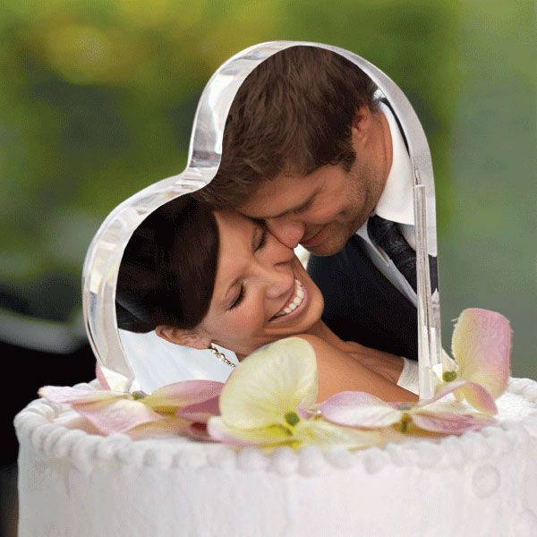 I kinda like this one.. ditching the traditional bride n groom statues with yourselves on top of the cake... hmm.. ; )