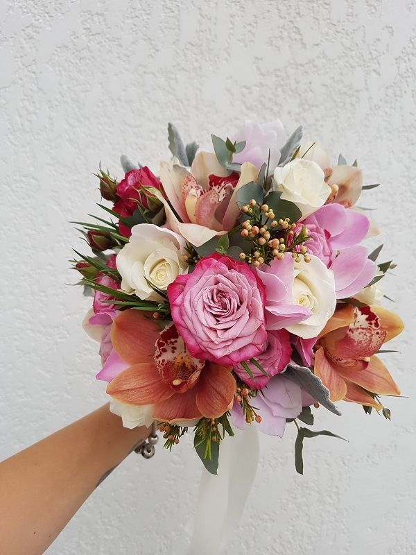 spring inspired wedding bouquet with roses and orchids
