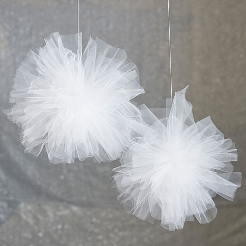 Our DIY White Tulle Poms are quick and easy to make! Make any party precious with the additions of white tulle pom poms.