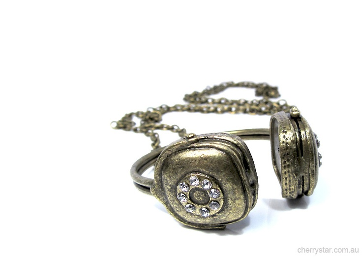 Headphones on. World off.  Chunky headphone necklace in antiqued bronze tone.  Diamante detail.  Headphones are approximately 5cm long.