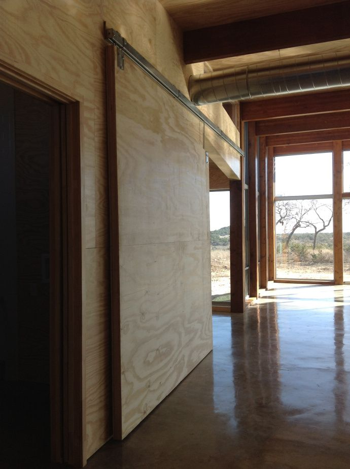 Exceptional Waxed Concrete Floor And Plywood Walls Nice Ideas