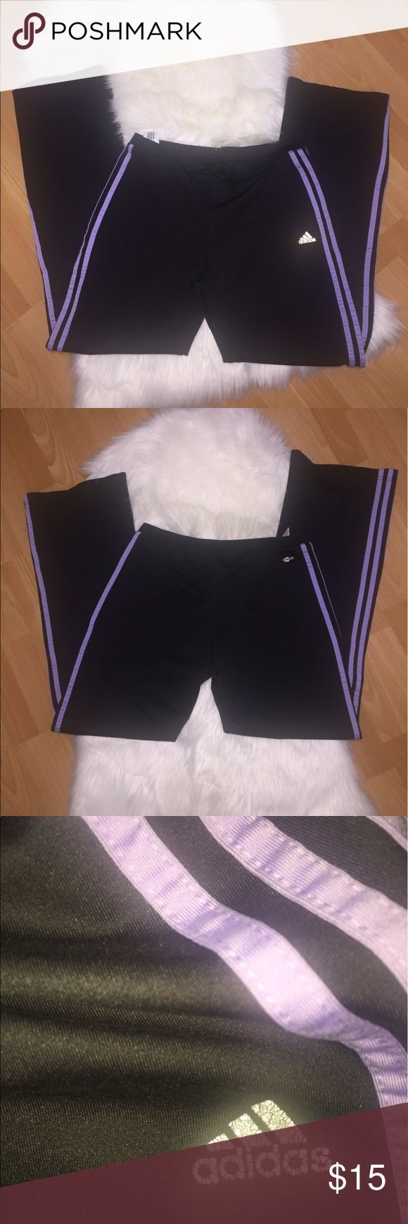 Adidas purple striped climate track pants Size large Women's. stretchy waist band and fabric that zips up. The traditional 3stripes run vertically on each leg with a purple stripe. The adidas logo and climate wording on the front and back are worn and peeling of but still legible. Adidas Pants Track Pants & Joggers