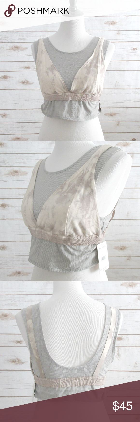 Free People Oasis Yoga Sport Bra Camisole Free People Oasis sports bra camisole combo.  The top has a layered camisole look with a soft bralette on the outside.  It is soft to the touch. I would recommend for yoga or low impact activities. Straps are not adjustable.  Condition: NWOT Type: Bra Style:  Sports bra Cami Brand: Free People Movement Size:  L Color: Peach (Gray Beige Tan) Material: Rayon Spandex  DD0.5:201801231035:1000:002F Free People Intimates & Sleepwear Bras