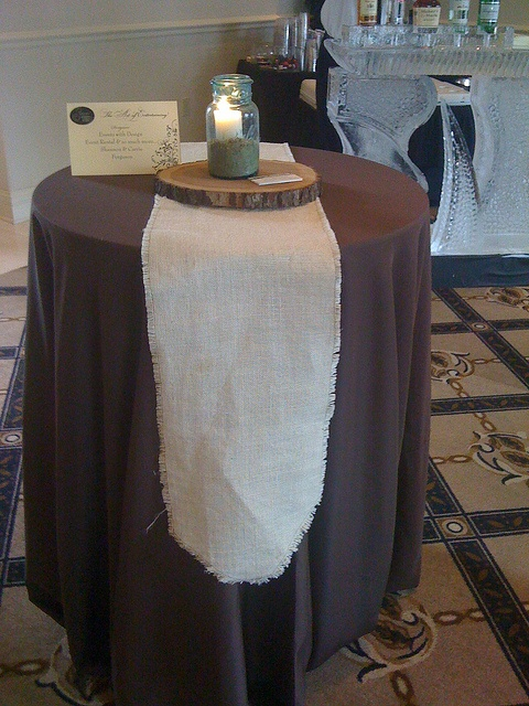 "Natural color burlap runners. For this display, used a chocolate  brown 120"" cloth with the burlap runners. Center piece of a  natural wood log section with a blue ball jar for a candle holder"