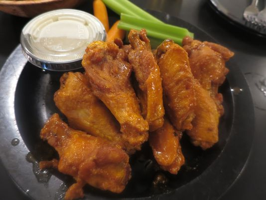 The Buffalo wing is one of America's most beloved and distinctive regional foods, and between the traditional wings at Duff's and creative variants at Bar Bill, it does not get much better.
