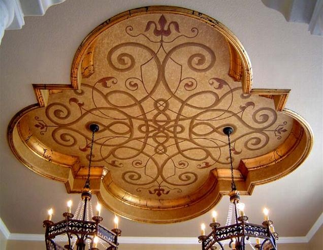 Beautiful ceiling by Jeff Huckaby. Note the gorgeous leaf on the molding and the seamless work in integrating both chandeliers!