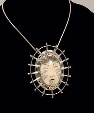 WOMAN OF POWER MASK Pin/Pendant Denise Wallace (Chugach/Sugpiaq, b. 1957) is a contemporary artist inspired by a timeless connection between her people and the northwest coast of North America.