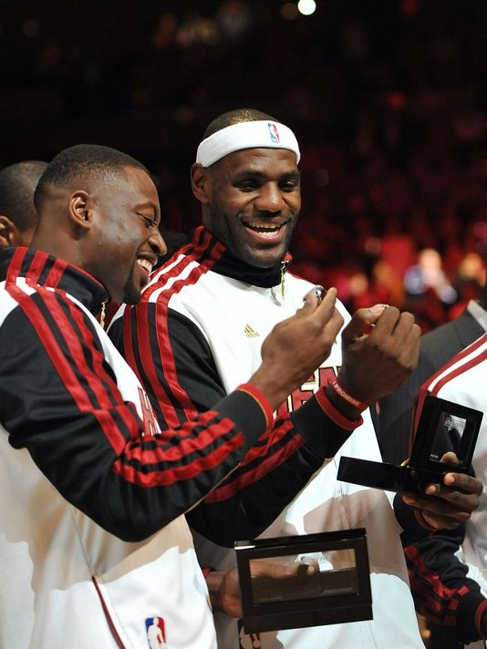 LeBron James NBA Championship Rings | Dwyane Wade and LeBron James admire their new NBA championship rings ...