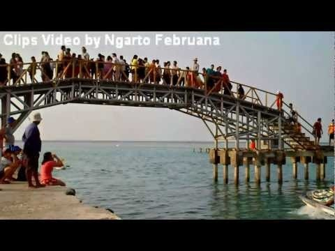 Jumping from The Lovely Bridge into the sea, one of the most favorite attraction in Tidung Island, Seribu Islands, near Jakarta, Indonesia.