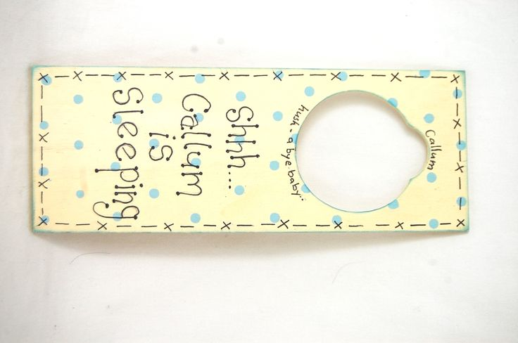 Our blank wooden door hangers have been basecoated with DecoArt acrylics, polka dots added and a personalised message was written with a glass pen.