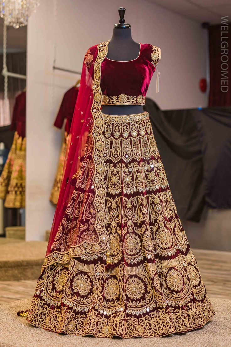 Maroon scalloped mirror work lengha.Scalloped dupatta border.Embellished with real mirrors and dubka embroidery .For this lehenga mail us contact@ladyselection.com