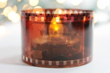 11 Awesome Oscars Party DIYs  Use film and battery operated candle tea lights to create film themed votives