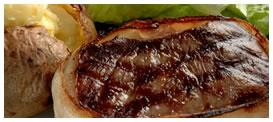 Applebee´s House Filet: Jugoso medallón de filete, envuelto en tocino grillado, acompañado de vegetales al vapor y papas. Foto referencial.