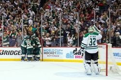 Minnesota Wild forward Erik Haula (56) celebrates his goal in the second period against the Dallas Stars goalie Kari Lehtonen (32) in game three of the first round of the 2016 Stanley Cup Playoffs at Xcel Energy Center.  #9258756