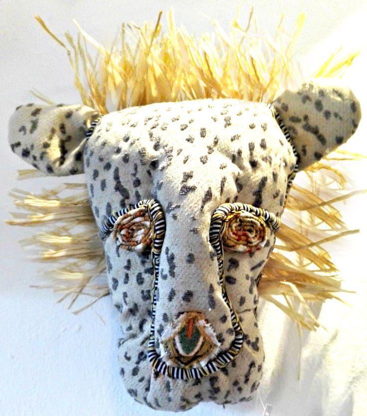 it's a lion, a cheetah....a leopard? Faux taxidermy - textile trophy