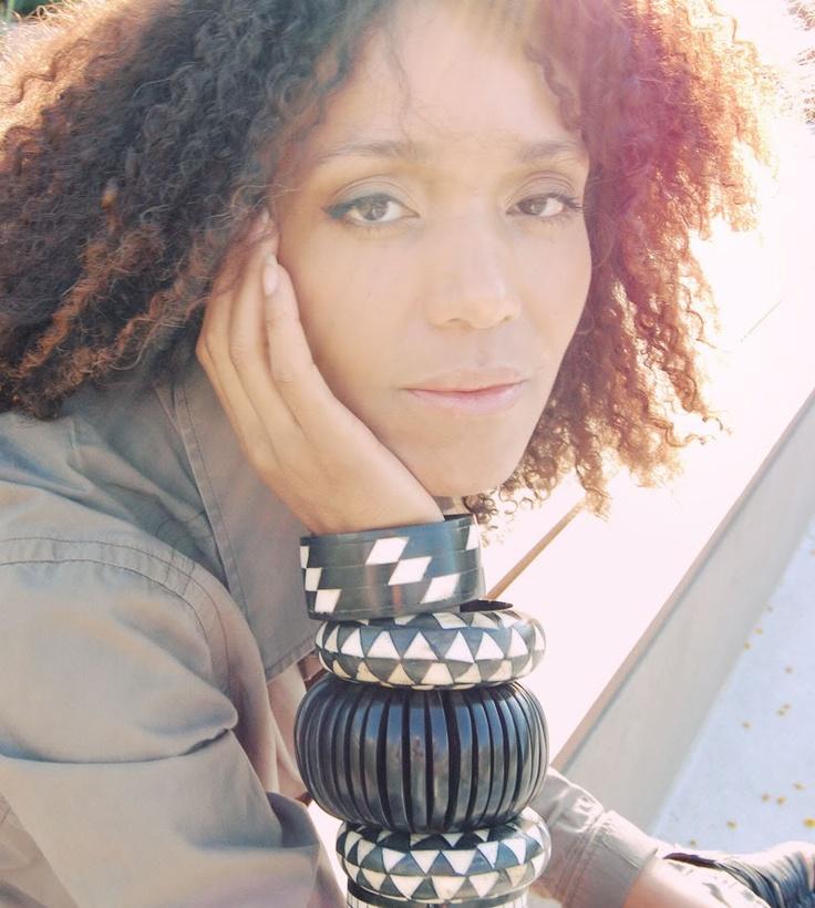 The Global Girl: Ndoema wears J Brand jeans in khaki, G-Star Raw Denim shirt, l.a.m.b. platform sandals, classic dooney bourke leather handbag and large ethnic black and white horn and wood bracelets.