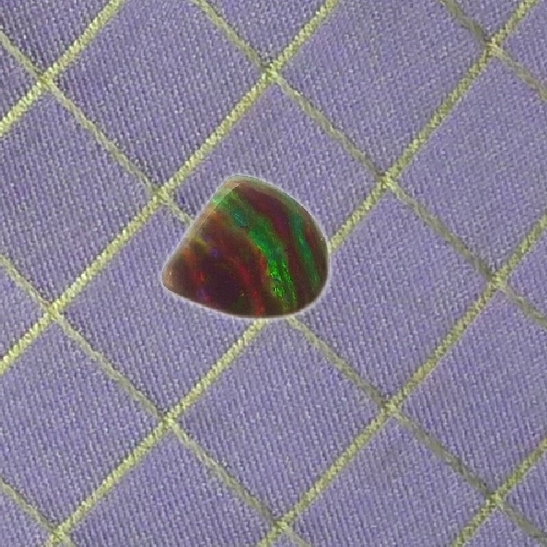 brown dark opal from the Ridge with strips of green, red and dark potch