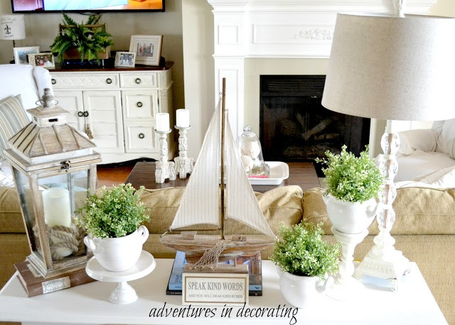Sofa table decor. Have a ship, Place by rope lamp  & coral on sofa table