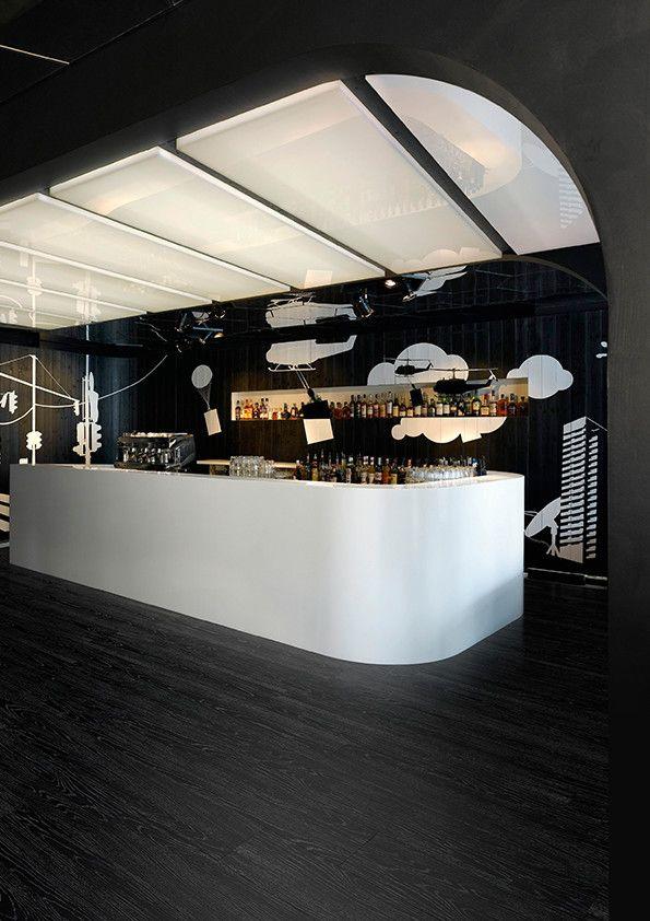 Affinity255 luxury vinyl flooring tiles in Jet Black Ash for stylish bar interior